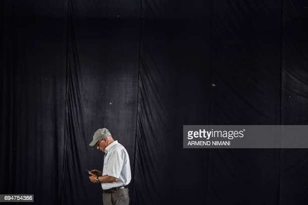 Kosovar man leaves a polling station in Pristina during early parliamentary elections in Kosovo on June 11 2017 Kosovo began voting for a new...