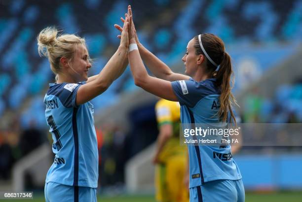 Kosovare Asllani and Izzy Christiansen of Manchester City Women celebrate their team's 5th goal during the WSL Spring Series Match between Manchester...