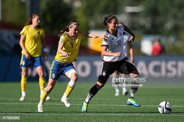 Kosovare Asllani of Sweden and Dzsenifer Marozsan of Germany battle for the ball during the FIFA Women's World Cup Canada 2015 Round of 16 match...