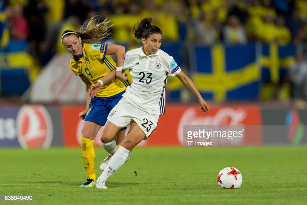 Kosovare Asllani of Sweden and Hasret Kayikci of Germany battle for the ball l during the Group B match between Germany and Sweden during the UEFA...