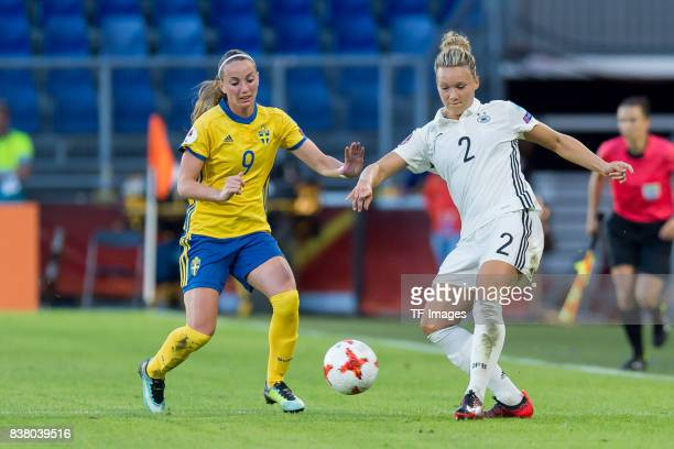 Kosovare Asllani of Sweden and Josephine Henning of Germany battle for the ball l during the Group B match between Germany and Sweden during the UEFA...