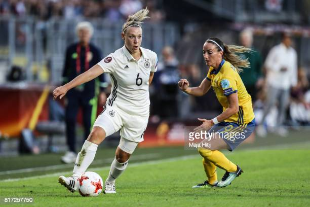 Kosovare Asllani of Sweden and Kristin Demann of Germany battle for the ball during the Group B match between Germany and Sweden during the UEFA...