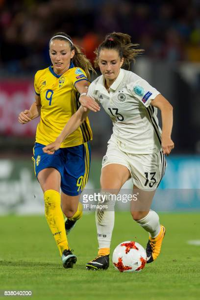 Kosovare Asllani of Sweden and Sara Daebritz of Germany battle for the ball l during the Group B match between Germany and Sweden during the UEFA...