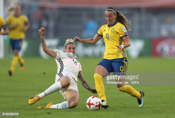 Kosovare Asllani of Sweden is tackled by Anja Mittag of Germany during the UEFA Women's Euro 2017 Group B match between Germany and Sweden at Rat...