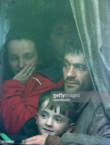 Kosovars From Pec Wait On A Bus After Crossing A Mountain Road Leading From The KosovoMontenegro Border Tuesday March 30 1999 After Being Forced To...