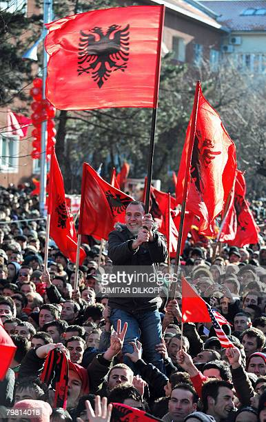Kosovars wave flags and shout slogans as they celebrate the independence of Kosovo in the center of the capital Pristina on February 17 2008 Kosovo's...