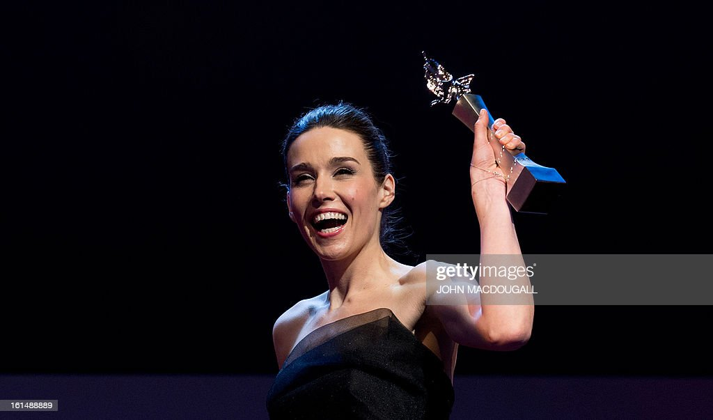 Kosovo actress Arta Dobroshi holds up her Shooting Star award during the 63rd Berlinale Film Festival in Berlin February 11, 2013. The Shooting Star awards reward Europe's best young promising actors. AFP PHOTO / JOHN MACDOUGALL