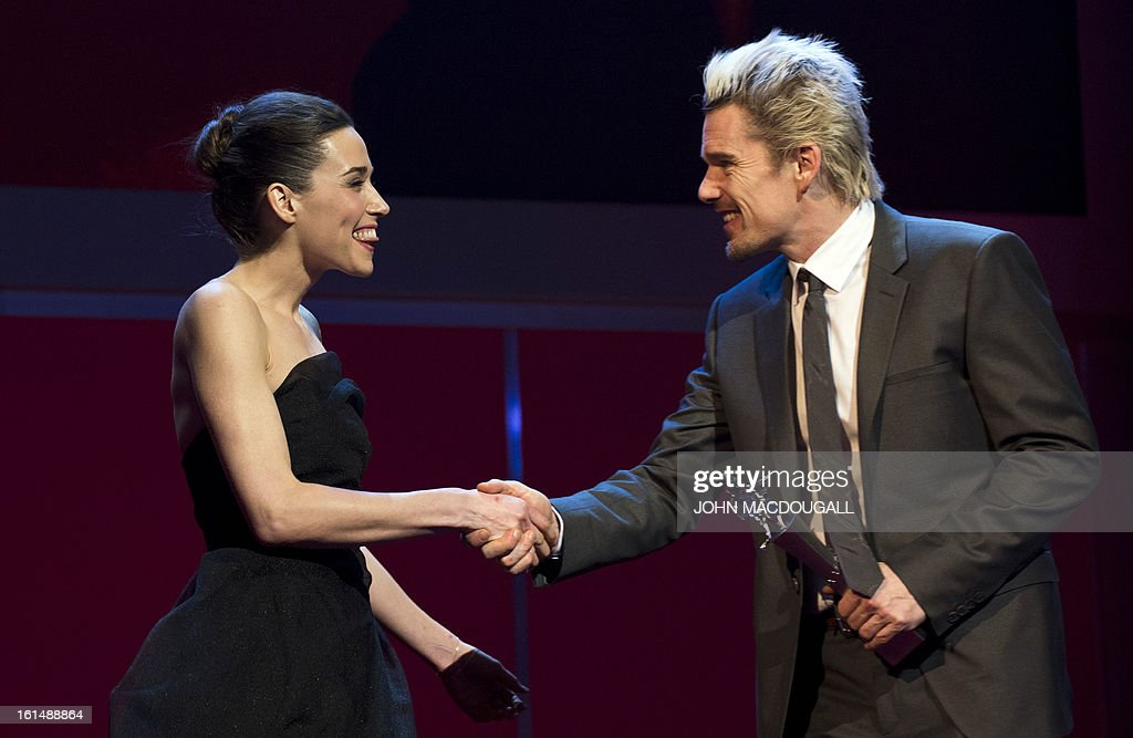 Kosovo actress Arta Dobroshi receives her Shooting Star award from US actor Ethan Hawke during the 63rd Berlinale Film Festival in Berlin February 11, 2013. The Shooting Star awards reward Europe's best young promising actors.