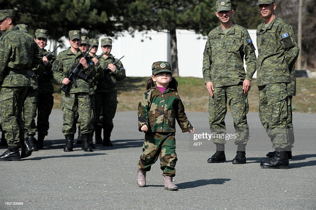 A Kosovo Albanian child dressed in a military costume takes part in a ceremony in Pristina on March 5, 2013 marking the 15th anniversary of the killing of Kosovo Liberation Army (KLA) commander Adem Jashari. Jashari was among 45 members of his family killed by Serb security forces in the vilage of Prekaz some 40 kms west of the Kosovo capital Pristina, sparking a full-blown rebel insurgency.