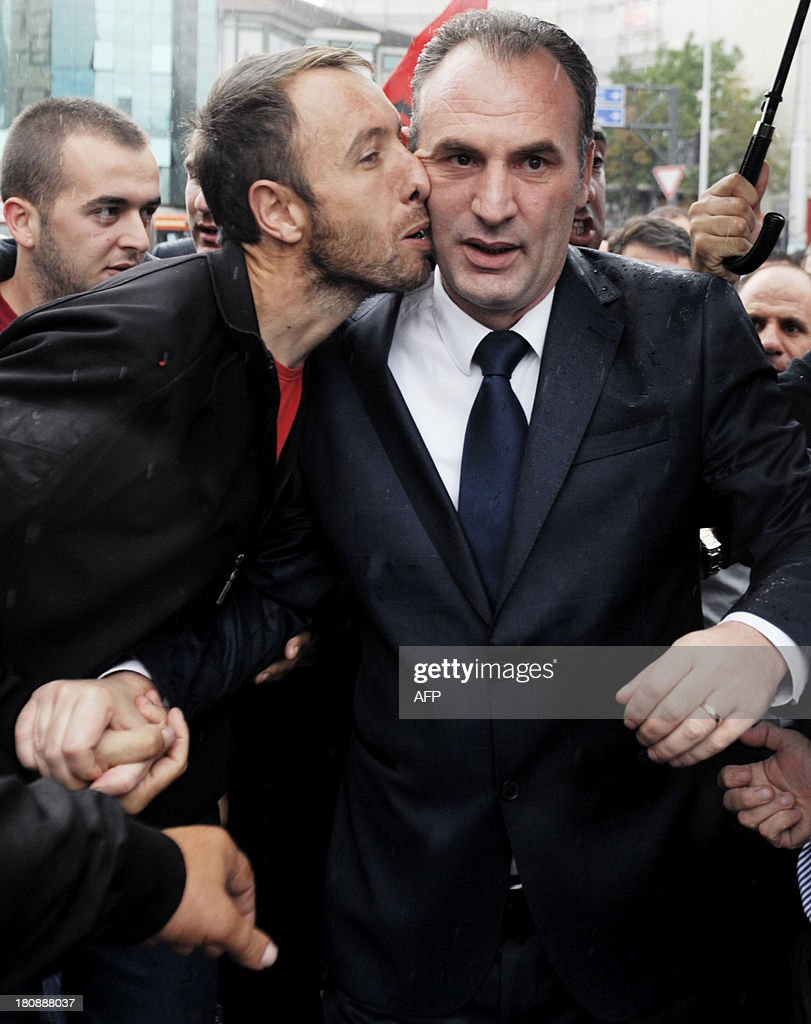 A Kosovo Albanian man kisses the former Kosovo Liberation Army (KLA) commander Fatmir Limaj after his acquittal in Pristina on September 17, 2013. A EU-led court set on Tuesday a top Kosovo rebel commander and his nine associates free from charges of war crimes in Kosovo.