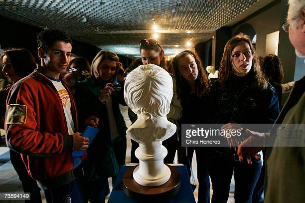 Kosovo Albanian students on a field trip from a outlying province looks at copy of a famous bust in the Museum of Kosovo March 15 2007 in Pristina...