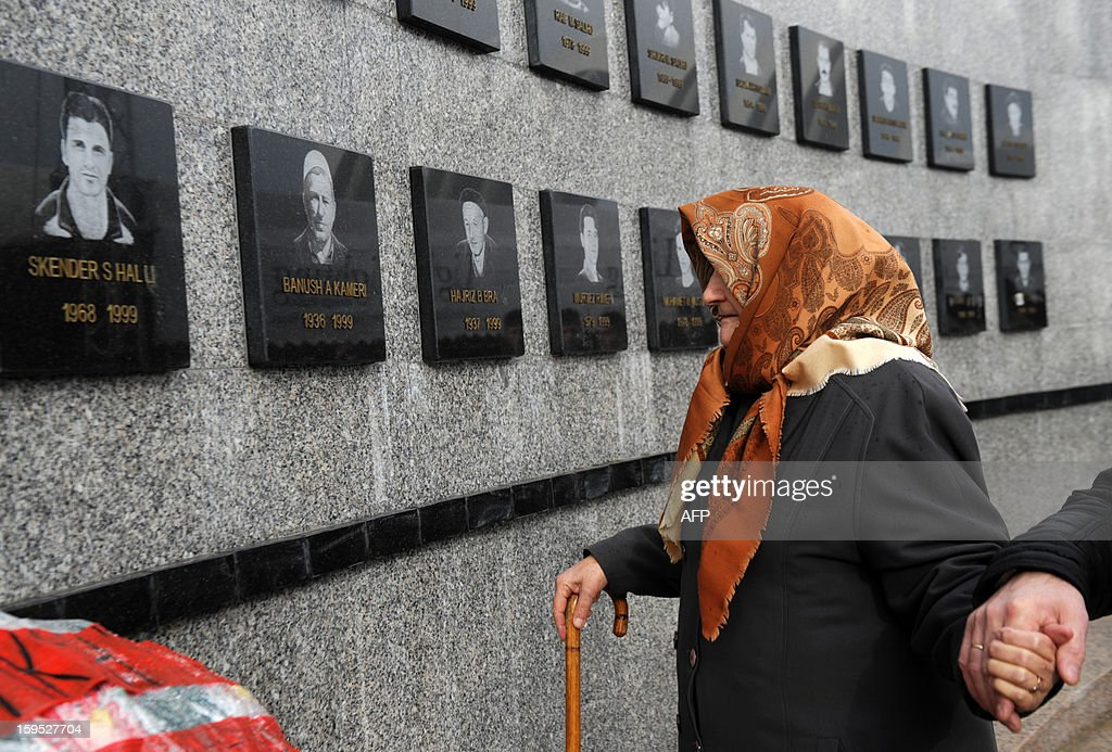 A Kosovo Albanian woman pays tribute to her relatives during the 14th anniversary of the Recak massacre on January 15, 2013. In 1999, forty-five Albanian civilians were killed by Serb forces, in the village of Recak. The massacre, one of the bloodiest that occurred in the Kosovo crisis, led to massive international pressure on Serbia to stop their ethnically motivated killings of civilian Albanians and to a NATO led air campaign that ousted Serbian security forces from Kosovo.