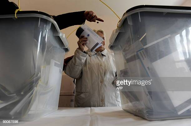 A Kosovo Albanian women casts her ballot at a polling station in Pristina on November 15 2009 Kosovo citizens went to the polls Sunday for the first...