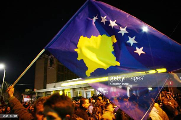 Kosovo Albanians celebrate on the day their prime minister proclaimed Kosovo 'an independent sovereign and democratic state' February 17 2008 in...