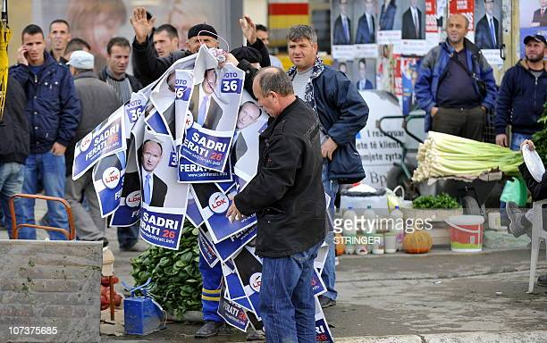 Kosovo Albanians hold up electoral posters during an electoral campaign in Mitrovica on December 7 2010 Kosovo on December 1 started a 10day campaign...