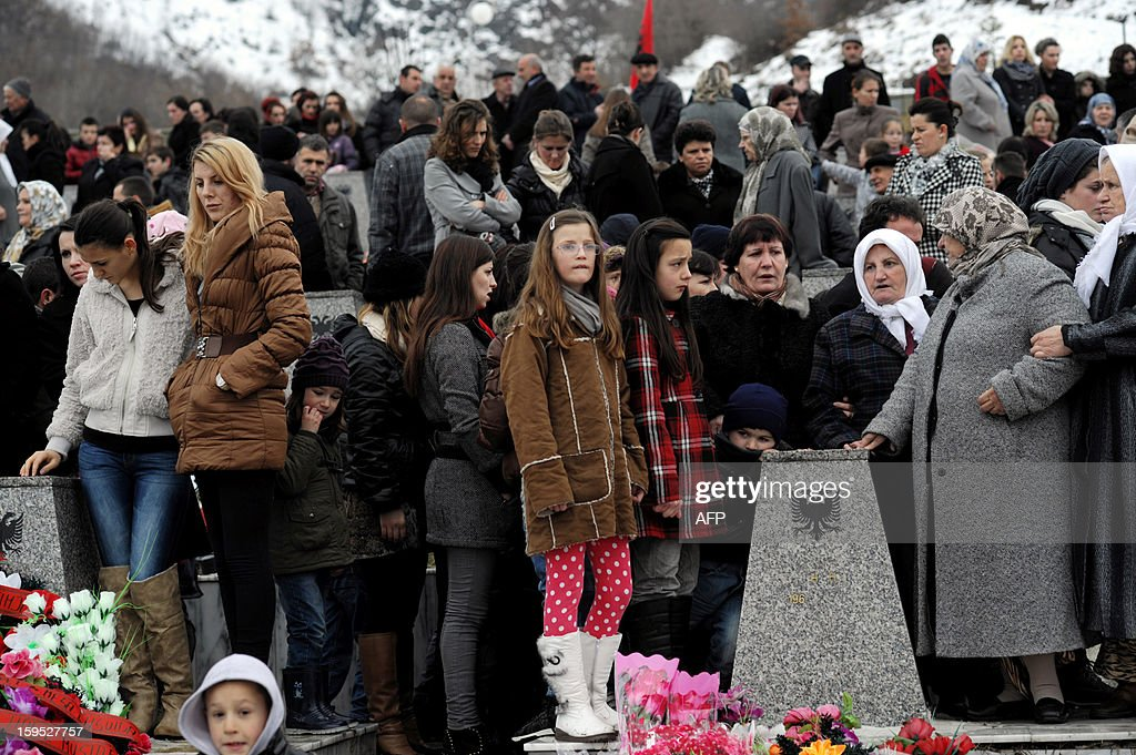 Kosovo Albanians pay tribute to their relatives during the 14th anniversary of Recak massacre on January 15, 2013. In 1999, forty-five Albanian civilians were killed by Serb forces, in the village of Recak. The massacre, one of the bloodiest that occurred in the Kosovo crisis, led to massive international pressure on Serbia to stop their ethnically motivated killings of civilian Albanians and to a NATO led air campaign that ousted Serbian security forces from Kosovo. AFP PHOTO/ARMEND NIMANI
