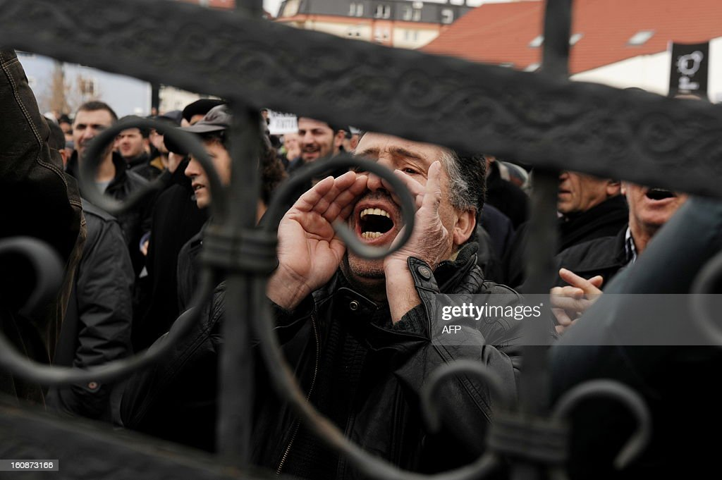 Kosovo Albanians shout slogans during a protest against rising electricity and inflated bills by Kosovo Energy Corporation (KEK). Hundreds of citizens have expressed their revolt in Pristina on February 7, 2013 since January bills have come up with much higher prices compared to other months.