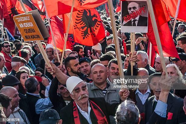 Kosovo Albanians some holding Alkbania's flag gather in Pristina on February 172016 for a major antigovernment rally to mark their eighth anniversary...