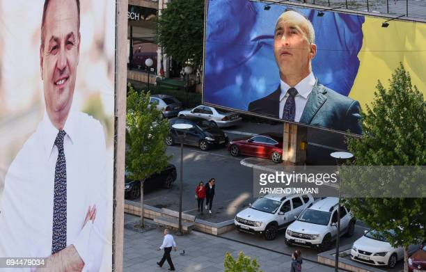 Kosovo Albanians walk past electoral banners in Pristina on June 8 2017 Nine years after proclaiming independence fragile Kosovo votes on June 11 at...
