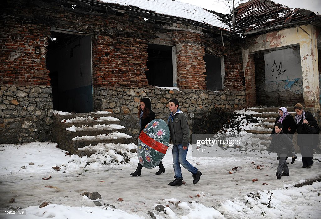 Kosovo Albanians walk toward a cemetery to pay tribute to their relatives during the 14th anniversary of Recak massacre on January 15, 2013. In 1999, forty-five Albanian civilians were killed by Serb forces, in the village of Recak. The massacre, one of the bloodiest that occurred in the Kosovo crisis, led to massive international pressure on Serbia to stop their ethnically motivated killings of civilian Albanians and to a NATO led air campaign that ousted Serbian security forces from Kosovo. AFP PHOTO/ARMEND NIMANI