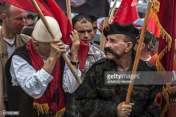 Kosovo Albanians wave Kosovo Liberation Army flags during a protest in Pristina on June 17 against the creation of a new EUbacked court that will try...