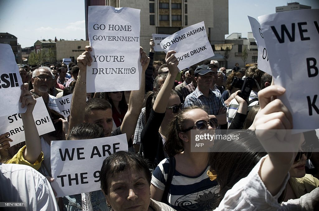 Kosovo Albanians wave placards reading 'Go Home Government You're Drunk' 'Go Home Hashim (eds: Hashim Thaci, Kosovo Prime Minister, and shout slogans as they march during a protest in Pristina on A...