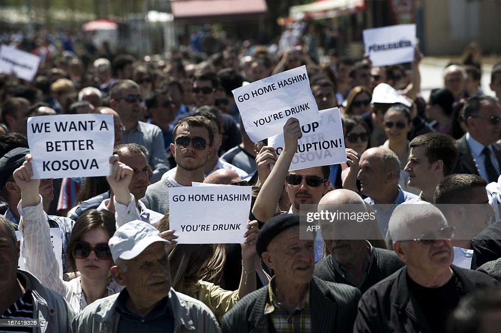 Kosovo Albanians wave placards reading 'Go Home Government You're Drunk' 'Go Home Hashim (eds: Hashim Thaci, Kosovo Prime Minister, and shout slogans shout slogans as they march during a protest in Pristina on April 25, 2013. A few thousand Kosovars protested in Pristina against government corruption and against rising electricity and inflated bills by Kosovo Energy Corporation (KEK) .