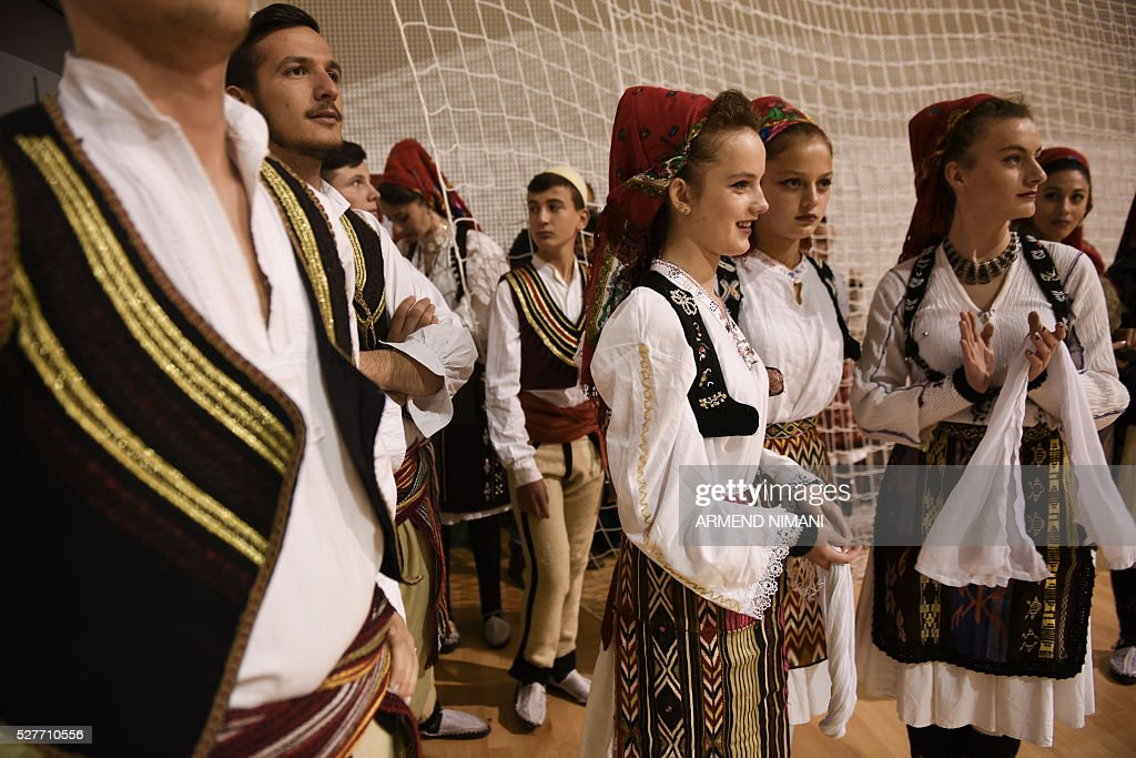 Kosovo Albanians wearing traditional costumes celebrate Kosovo's admission to UEFA, on May 3, 2016 in Mitrovica. UEFA admitted Kosovo as its 55th member in a narrow vote on May 2, boosting its hopes of competing in the 2018 World Cup despite warnings from former ruler Serbia. / AFP / ARMEND