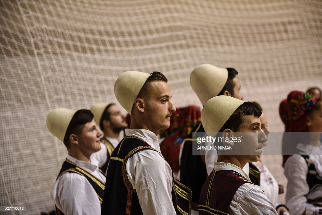 Kosovo Albanians wearing traditional costumes take part in a celebration of Kosovo's admission to UEFA, on May 3, 2016 in Mitrovica. UEFA admitted Kosovo as its 55th member in a narrow vote on May 2, boosting its hopes of competing in the 2018 World Cup despite warnings from former ruler Serbia. / AFP / ARMEND