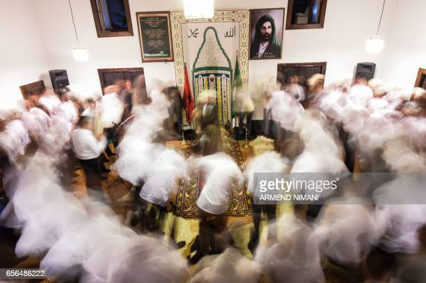 TOPSHOT Kosovo dervishes adept of Sufism a mystical form of Islam take part in a ceremony in a prayer room in Gjakova on March 21 2017 during Newroz...