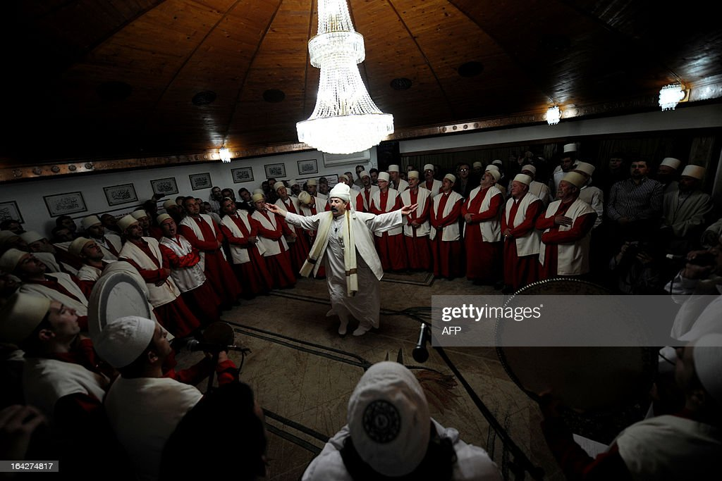 Kosovo dervishes, adepts of Sufism, a mystical form of Islam that preaches tolerance and a search for understanding, take part in a ceremony in the prayer room of the town of Gjakova on March 21, 2013. The Kosovo dervish community carries on centuries-old mystical practices, such as self-piercing with needles and knives as a way to earn salvation and find the path to God. AFP PHOTO /ARMEND NIMANI