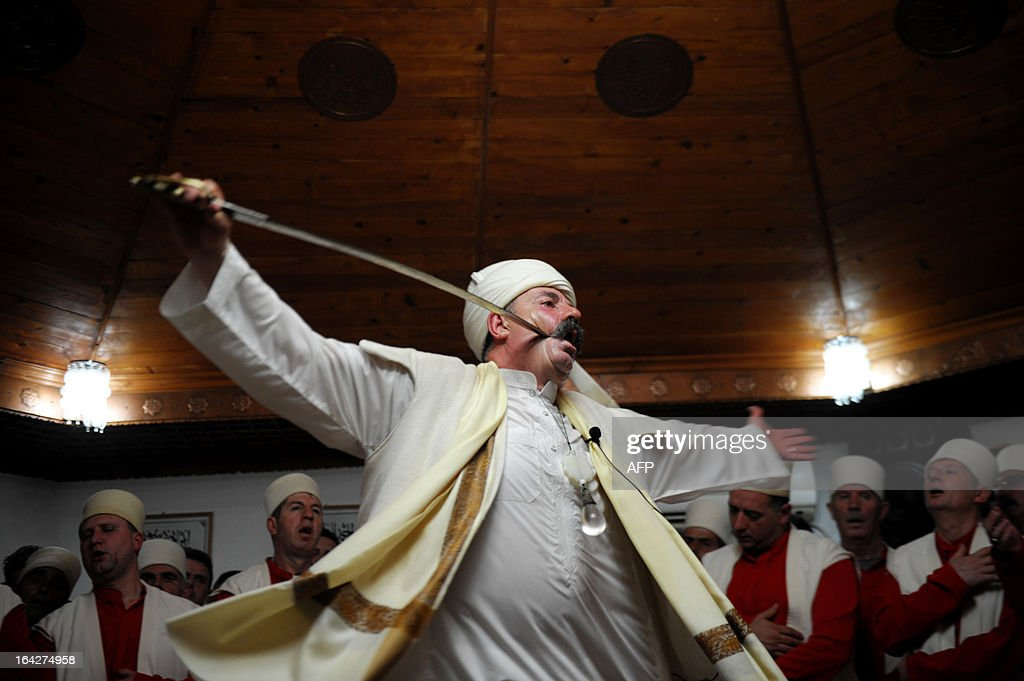 Kosovo dervishes, adepts of Sufism, a mystical form of Islam that preaches tolerance and a search for understanding, take part in a ceremony in the prayer room in the town of Gjakova on March 21, 2013. The Kosovo dervish community carries on centuries-old mystical practices, such as self-piercing with needles and knives as a way to earn salvation and find the path to God. AFP PHOTO /ARMEND NIMANI