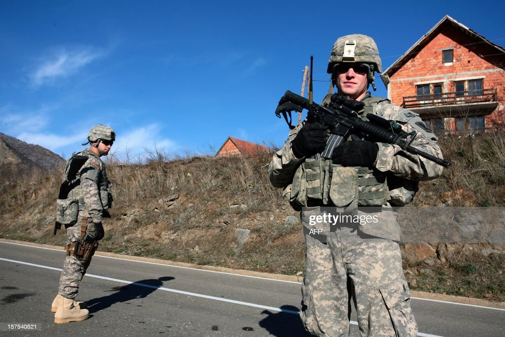 Kosovo Force (KFOR) soldiers from the US patrol on a road near Serbia-Kosovo border crossing of Jarinje on December 4, 2012. Kosovo Serbs protested against the construction of border crossings between Serbia and Kosovo before leaders from the two countries met to hammer out details of a European Union-brokered plan on border management.