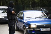 Kosovo police guard outisde the apartment of the vice chairman of radical Islamic political party Fuad Ramiqi during the police raid in Pristina on...