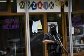 Kosovo police guards the entrance of the apartment of the vice chairman of radical Islamic political party Fuad Ramiqi during the police raid in...