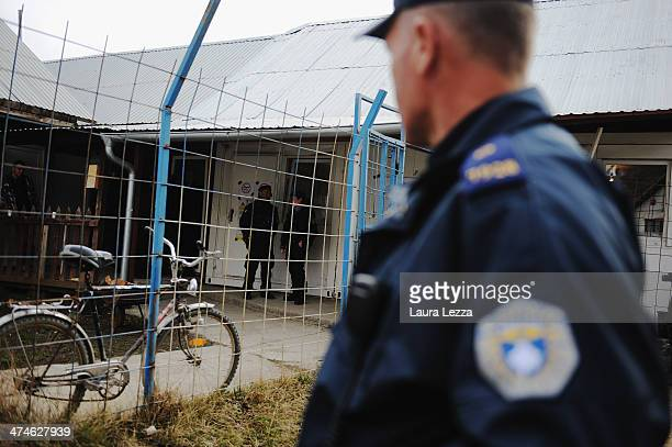 Kosovo Police man stand outside a polling station during elections in Mitrovica North to elect the Mayor on February 23 2014 in Mitrovica Kosovo The...