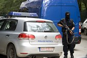 Kosovo police stands guard outside the apartment of the vice chairman of radical Islamic political party Fuad Ramiqi during the police raid in...