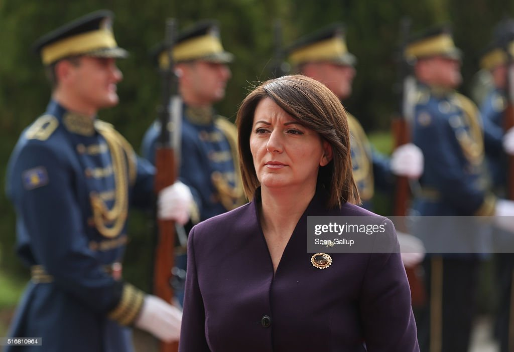 Kosovo President <a gi-track='captionPersonalityLinkClicked' href=/galleries/search?phrase=Atifete+Jahjaga&family=editorial&specificpeople=7799061 ng-click='$event.stopPropagation()'>Atifete Jahjaga</a> walks past a Kosovar guard of honour as she arrives at the Assembly of Kosovo, the Kosovoso parliament building, on March 19, 2016 in Pristina, Kosovo. Kosovo, following the Kosovo War of 1999 and its new-found independence, is still burdened with ethnic rifts and a weak economy.