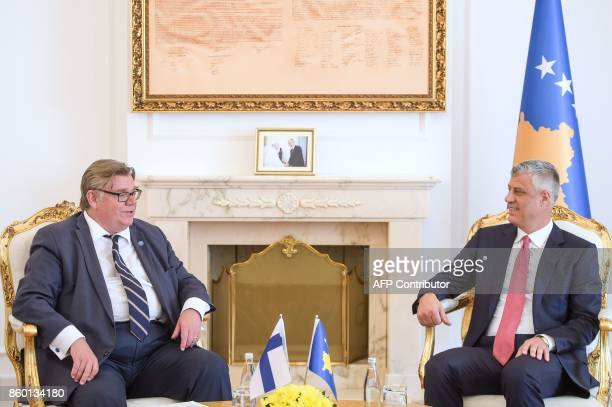 Kosovo President Hashim Thaci sits with Finnish Minister of Foreign Affairs Timo Soini following their meeting in Pristina on October 11 2017 / AFP...
