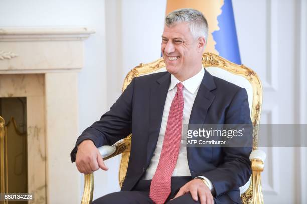 Kosovo President Hashim Thaci smiles as he sits with the Finnish Minister of Foreign Affairs following their meeting in Pristina on October 11 2017 /...
