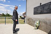 Kosovo President Hashim Thaci stands after laying a wreath of flowers in front of the memorial in the village of Gracke on July 20 remembering the...