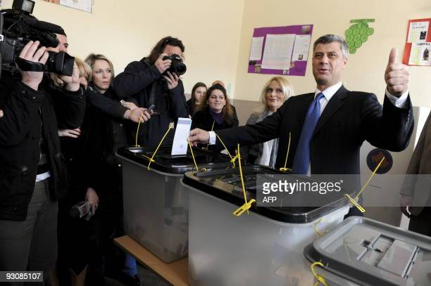 Kosovo Prime Minister Hashim Thaci casts his ballot at a polling station in the capital Pristina on November 15 2009 Kosovo citizens went to the...