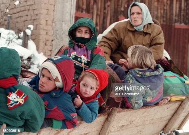 Kosovo refugees peer down from a tractor as they flee through the mountains near the village of Lupq I Eperem 40 km north of Kosovo^s capital of...