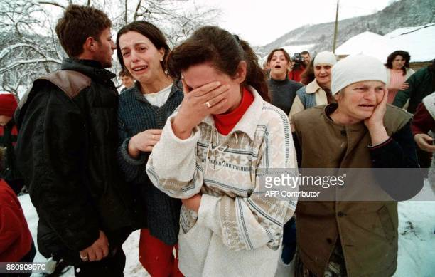 Kosovo refugees weep as they flee the village of Lupq I Eperem 29 January Serbian security forces launched a new attack with tanks and heavy...