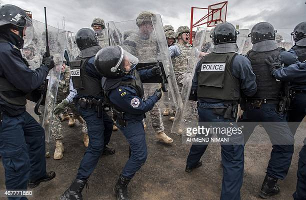 Kosovo Riot policemen and US soldiers of the NATOled peacekeeping force take part in a crowd and riot control exercise near the town of Ferizaj on...
