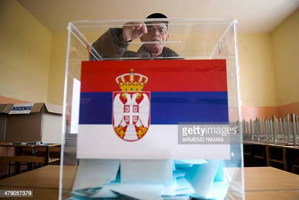 A Kosovo Serb man casts his ballot at a polling station in the town of Gracanica on March 16 2014 Voters in Serbia cast their ballots in snap polls...