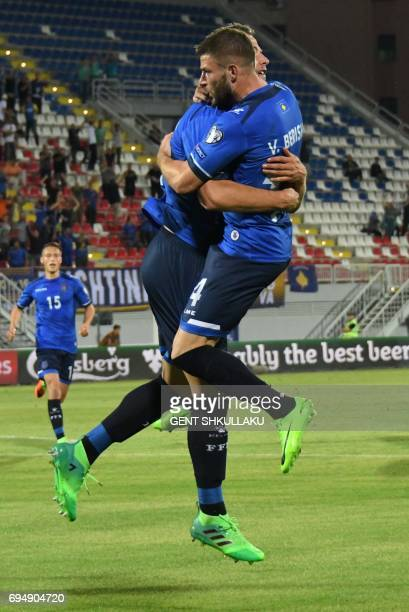 Kosovo's Amir Rrahmani celebrates with teammate Valon Berisha after scoring during the FIFA World Cup 2018 qualification football match between...