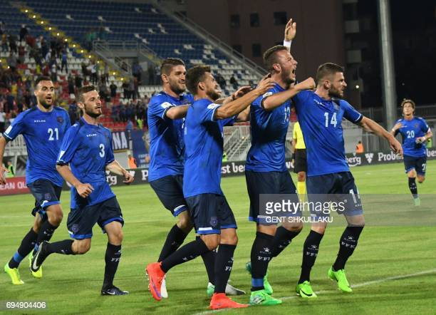 Kosovo's Amir Rrahmani celebrates with teammates including Valon Berisha after scoring during the FIFA World Cup 2018 qualification football match...