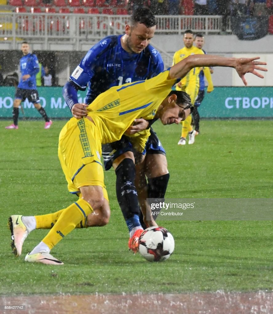 Kosovo's defender Amir Rrahmani (L) fights for the ball with Ukraine's midfielder Denys Harmash (R) during the FIFA World Cup 2018 qualification football match between Kosovo and Ukraine at The Loro Borici Stadium in Shkoder on October 6, 2017. / AFP PHOTO / Gent SHKULLAKU