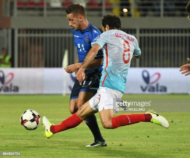 Kosovo's Donis Avdijaj is tackled by Turkey's Selcuk Inan during the FIFA World Cup 2018 qualification football match between Kosovo and Turkey at...